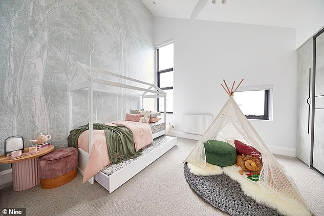 Plenty of room for all the family: Pictured is the pair's kids' bedroom, which they styled with a teepee play tent