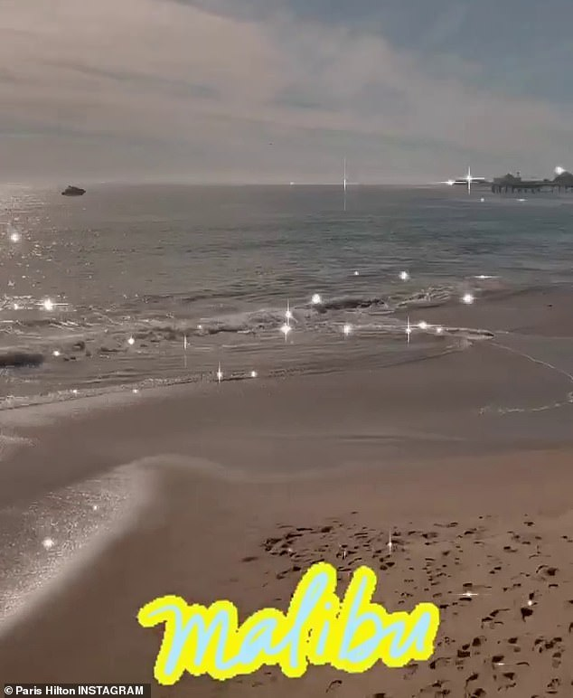 Beach babe: Paris took to her Instagram Story from their lunch outing at the oceanfront sushi eatery, showing off the gorgeous beach view
