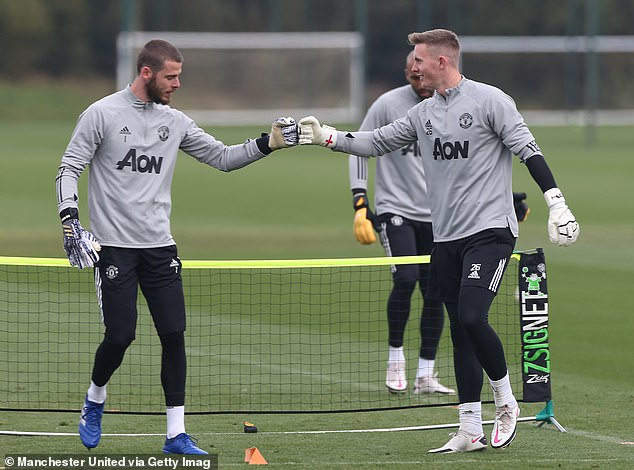 Henderson (right) has been unable to dislodge David de Gea (left) as United's first choice