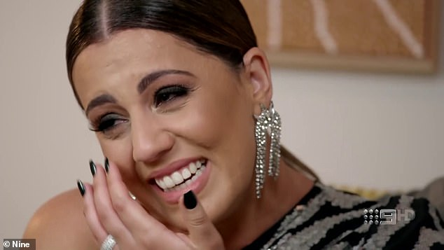 Emotional: Wiping away tears of joy from her face, Sarah remarked on camera that 'it's nuts'