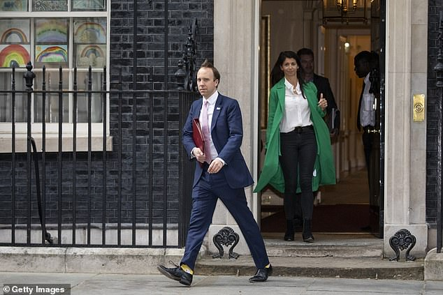 Mr Hancock leaving 10 Downing Street with Gina Coladangelo on May 1, when she is reported to have been acting as an unpaid adviser to the Health Secretary