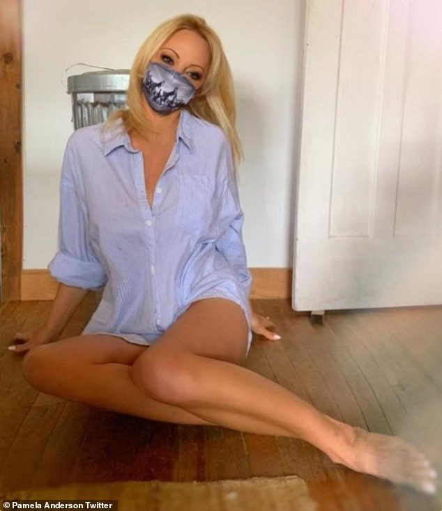 Stunning: Pamela Anderson, 53, put on a very leggy display as she posed in an oversized shirt and face covering on Twitter on Saturday