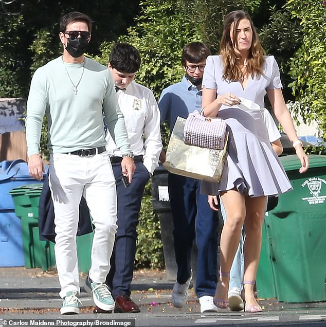 Stylish family: In attendance for the outing were his wife Rhea and two sons Brendan and Michael
