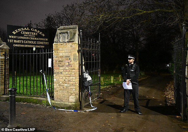 A police officer stands outside Kensal Green Cemetery after a fatal stabbing on Harrow Road in Kensal Green at around 2pm today