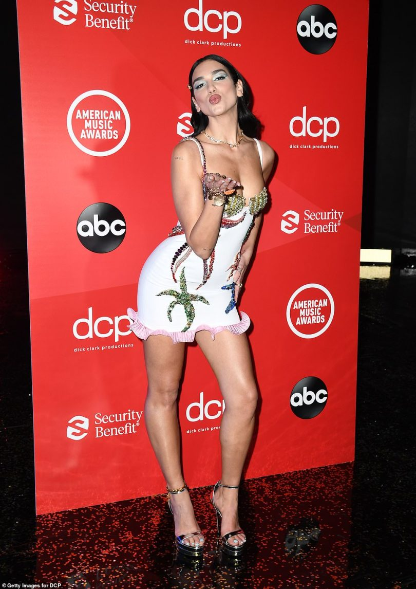 Rhinestone realness:Dua Lipa, 25, had her signature assets on full display in a quirky white mini dress that was decked out into in multi-toned rhinestones