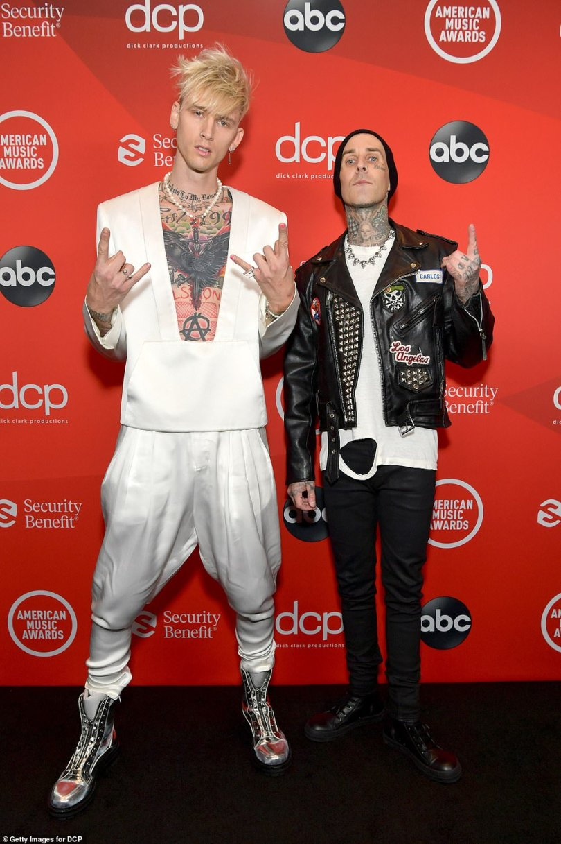 Third wheeling:Joining Megan and Kelly's red carpet debut was none other than Blink-182 drummer and producer Travis Barker