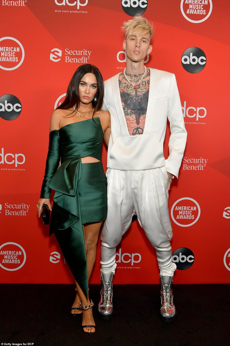 Hot couple:Machine Gun Kelly, who earned his first number one album this year, had his main gal Megan Fox, 34, by his side for the night as they posed for shutterbugs on the carpet