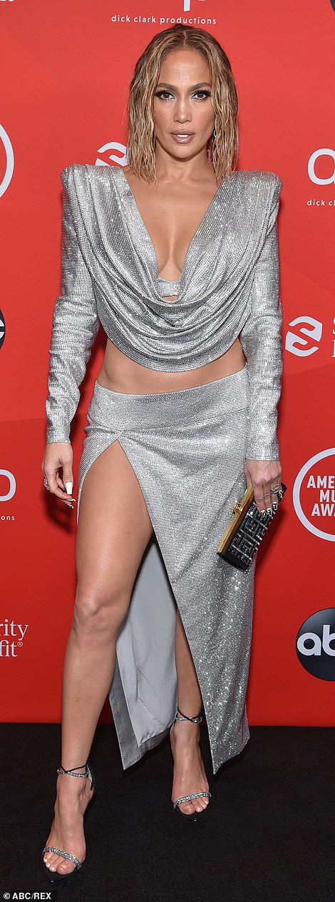 All the drama: The On The Floor singer's evening wear consisted of a plunging cowl neck top and a matching maxi skirt that featured a dramatic slit down one leg