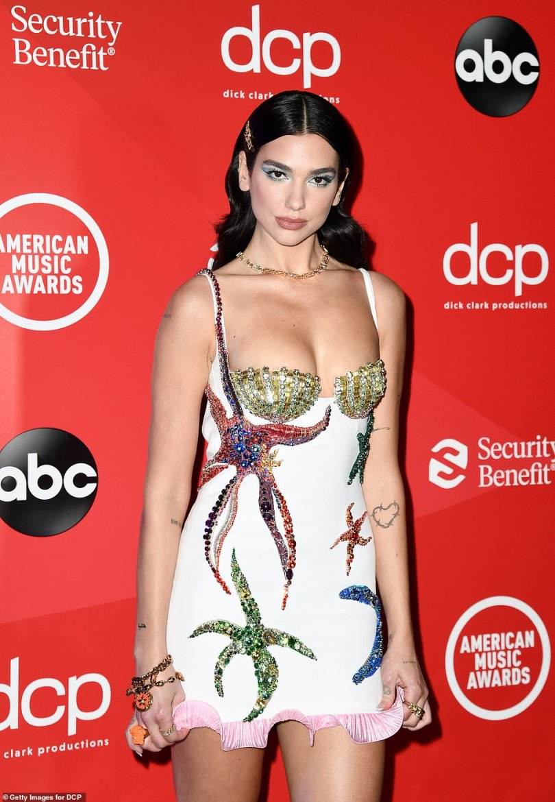 All in the details:The gems formed various images of starfish on Dua's figure-hugging silhouette and dominated the cups of her bustier top