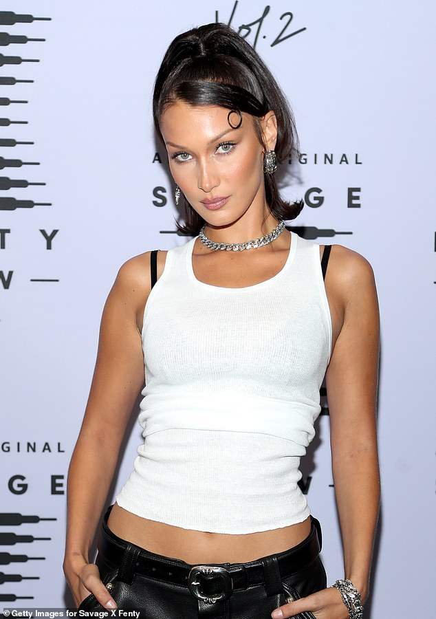 Bella Hadid adds to her growing tiny tattoo collection with two fine line Arabic inkings on each arm
