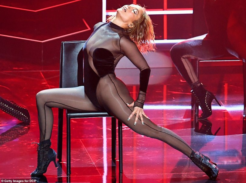 J-Lo and Megan Thee Stallion set pulses racing in see-through ensembles as they perform at the AMAs