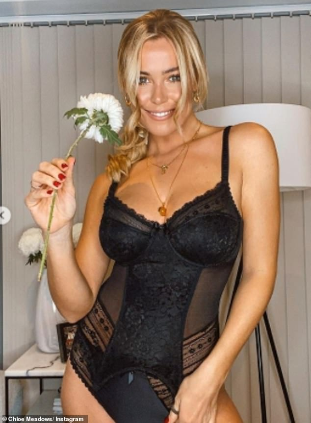 Blackout: The TOWIE star, 28, looked phenomenal in racy black lingerie complete with a bustier with suspender straps and a tiny pair of matching knickers