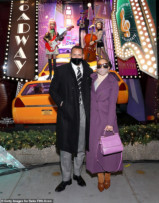 Jennifer Lopez and fiance Alex Rodriguez at the Saks Fifth Avenue Holiday Window Unveiling in NYC