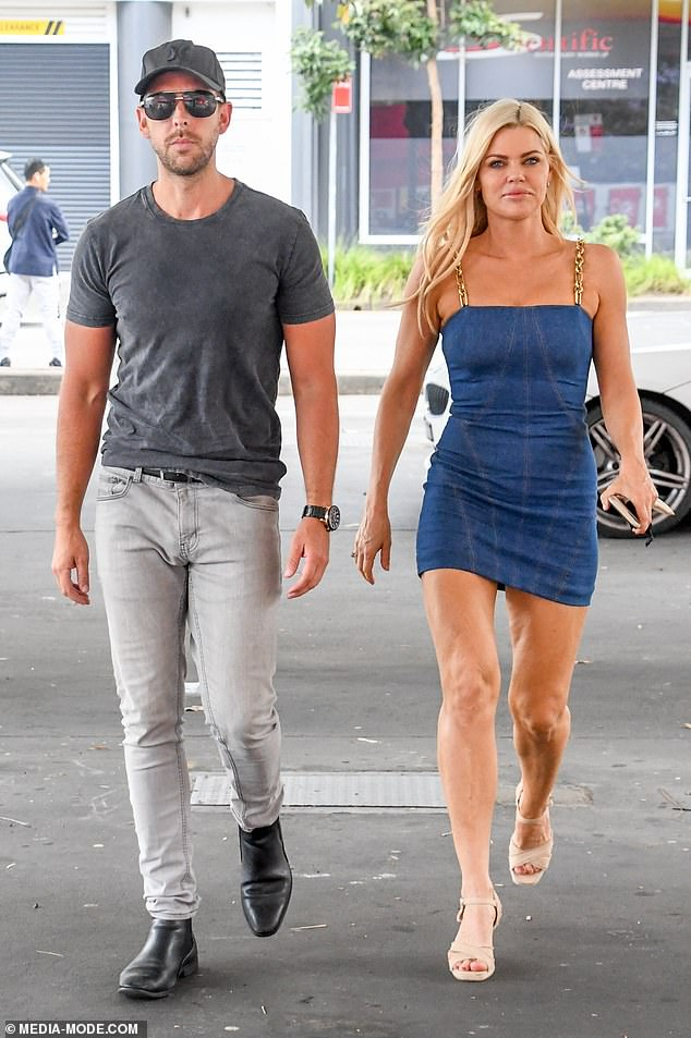Turning heads:Sophie Monk rocked up to a petrol station in Sydney on Saturday wearing a denim dress which highlighted her fabulous figure. Pictured with her boyfriend, Joshua Gross
