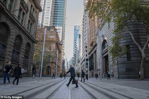 Ms Berejiklian said the public health direction that employees should work from home if able to do so will also be eased on December 14 (pictured, a view of George Street on June 1)