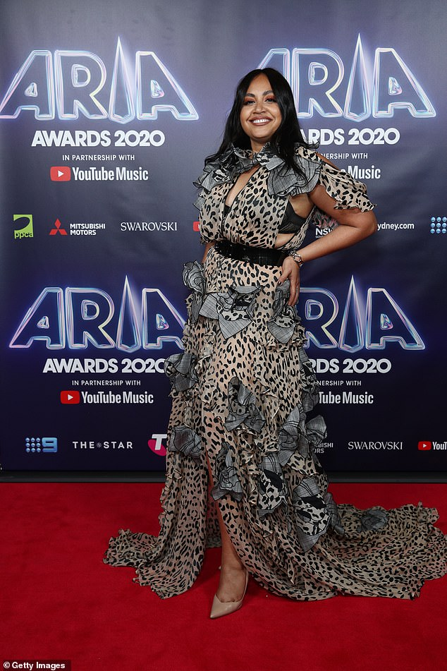 Animal instincts:Jessica Mauboy looked equally glamorous, opting for an elaborate leopard-print dress