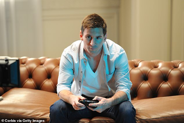 Lionel Messi, pictured on the set of the FIFA 15 TV commercial, has also been a cover star
