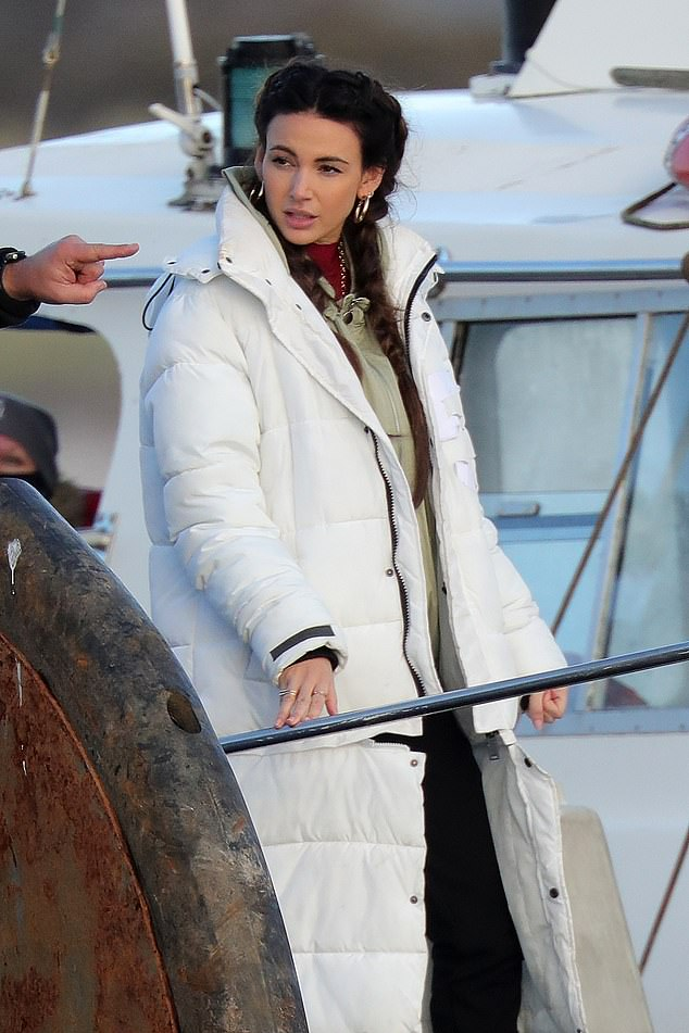 All at sea: The actress donned a white padded coat for the scenes shot on the water
