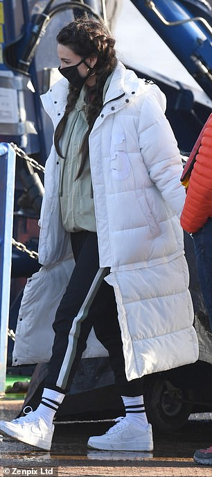 Comfy: Michelle also kept safe with a mask in between takes and was warm in her winter coat, joggers and socks and sneakers