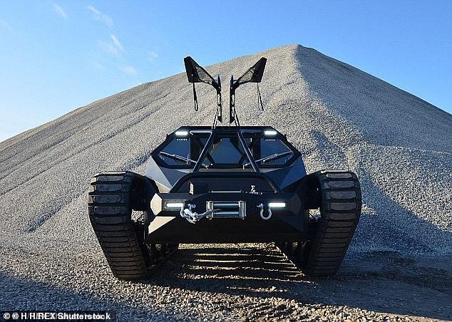 Owner: Kanye is fond of cars and was reported to have $3.8million invested in vehicles including a Ripsaw EV2 tank (pictured) at his Wyoming ranch
