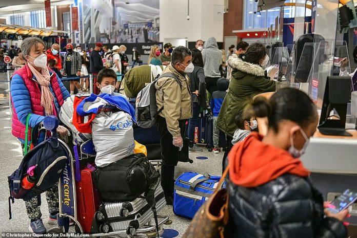 ATLANTA, GEORGIA: Millions of Americans have continued to ignore CDC guidance and dire warnings from public health officials to avoid Thanksgiving travel. Pictured above is the crowd waiting to check in for flights atAtlanta Hartsfield-Jackson International Airport yesterday morning