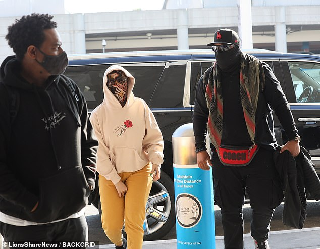 Mellow yellow: Complementing her top, Cardi opted for comfy mustard-colored sweatpants on bottom