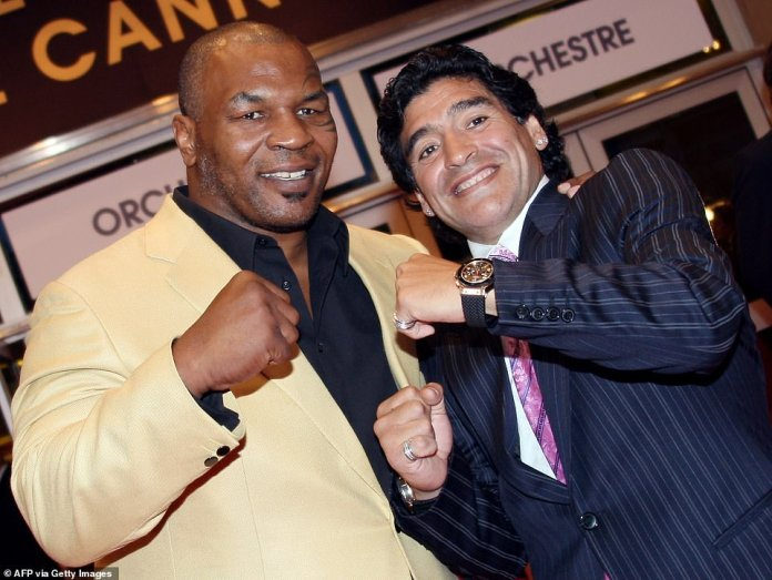 Former US boxing champion Mike Tyson (L) and former Argentinian football player Diego Maradona after arriving to attend the screening of US director Steven Soderbergh's film 'Che' at the 61st Cannes International Film Festival on May 21, 2008 in Cannes