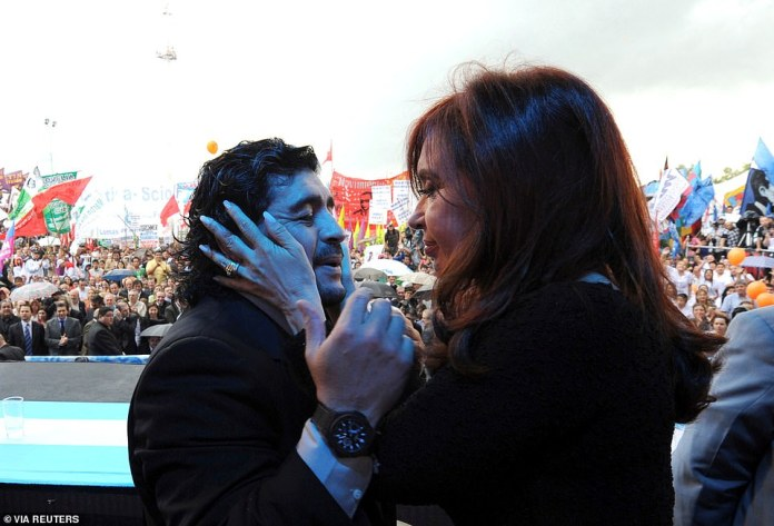 Argentina's President Cristina Fernandez de Kirchner (right) embraces former Argentine soccer star Diego Maradona during a rally in Buenos Aires, December 2, 2010