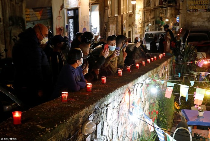 The citizens of Naples have headed out to the streets in silence to pay respects to Maradona