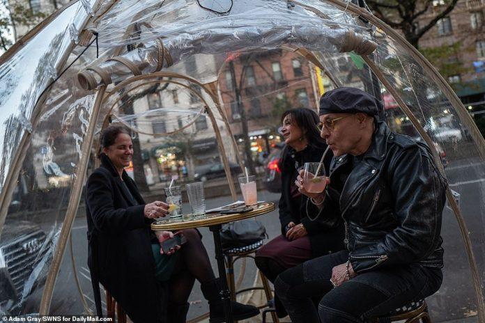 NYC: Patrons enjoy drinks inside an igloo at Cafe Du Soleil on Manhattan's Upper West Side on November 20