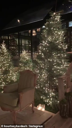 The moody themed Christmas bash featured simply decorated trees all over