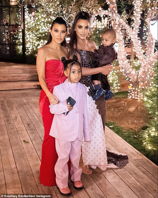 Wow: Outside, there were many more lit Christmas trees, as well as lights on the trees outside; Kourtney with sister Kim Kardashian, her niece North West and nephew Psalm West