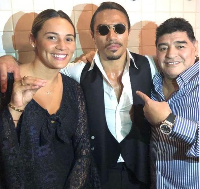 Maradona and his most recent girlfriend Rocio Oliva (left) posing with the viral steak chef Salt Bae
