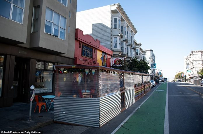 SAN FRANCISCO: A makeshift structure allows restaurant patrons to dine outdoors in San Francisco on Tuesday