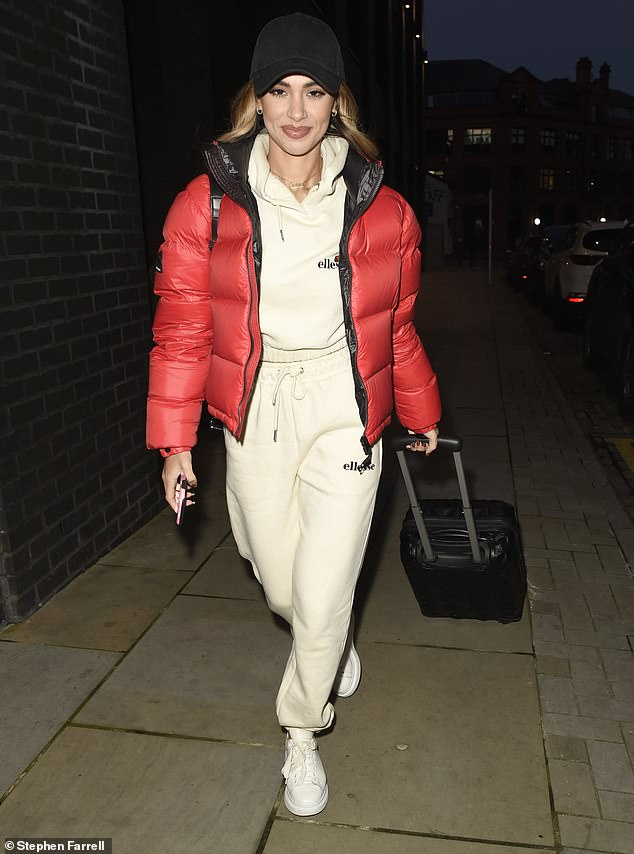 Effortlessly stylish: Joanna Chimonides, 24, opted for Ellesse jogging bottoms and a matching hoodie as she wrapped up a photo shoot for JD Sports in Manchester on Wednesday