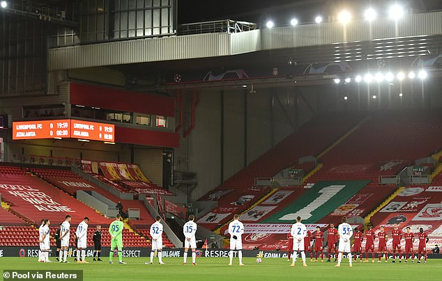 Both Liverpool and Atalanta's players surround the centre circle at Anfield to pay tribute