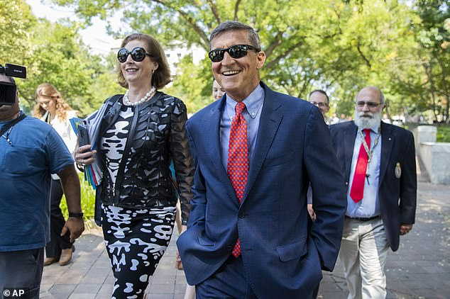 President Trump says he has pardonedMichael Flynn, his former national security adviser. Flynn is seen above with his lawyer Sidney Powell in September