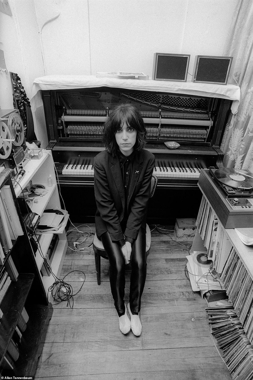 'One of the first things I had done for the SoHo News,' Tannenbaum told DailyMail.com about the above image, Patti Smith in her apartment, NYC, 1974.Tannenbaum knew Lenny Kaye, the guitarist in her group and after a show they went back to Smith's'small typical Village apartment,' he recalled. 'We were just hanging out and talking. I really like that portrait of her.' The next year, Smith released with her group their seminal debut album, Horses