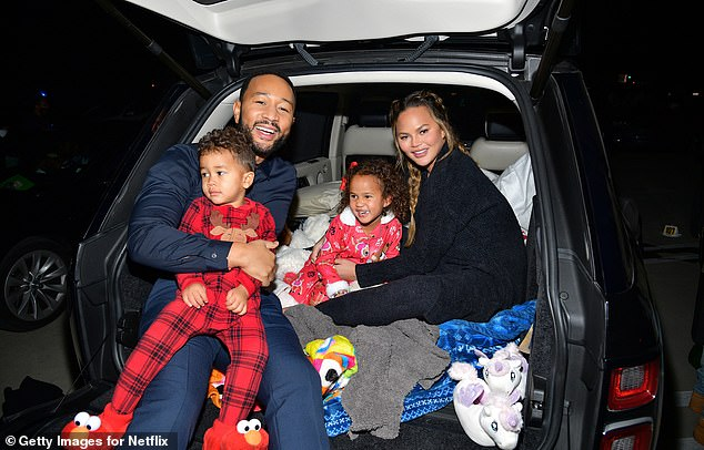 IVF:Chrissy and John, who tied the knot in Italy in September of 2013, conceived Luna and Miles through IVF treatment, while their surprise third pregnancy occurred naturally; John, Miles, Lune, and Chrissy pictured on November 13