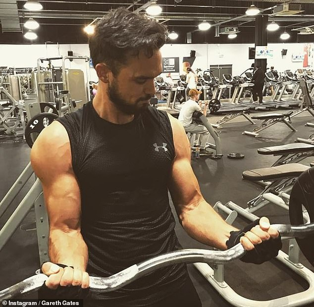 New look: The singer said he's embraced a healthier lifestyle and spends up to two hours in the gym everyday lifting weights