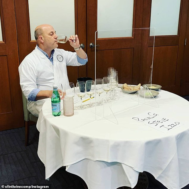 Wine tasters pictured trying unmarked glasses at this year's wine show in San Francisco