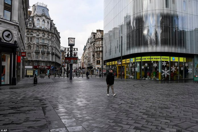 A nearly empty Leicester Square, in London, Tuesday, Nov. 24, 2020. Haircuts, shopping trips and visits to the pub will be back on the agenda for millions of people when a four-week lockdown in England comes to an end next week