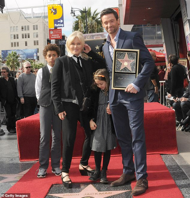 Embracing:She told People on Wednesday that she and her husband of 24 years, Hugh Jackman, have always embraced their children's heritage; Oscar, Deborra-lee, Ava, and Hugh pictured in 2012