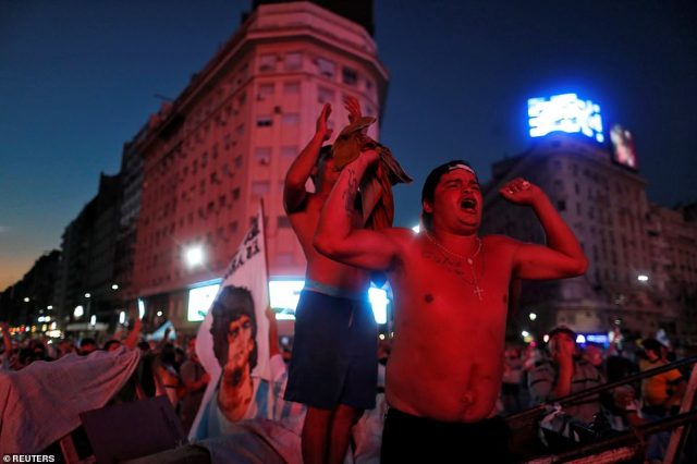 People mourn Maradona's death at the Obelisk in Buenos Aires last night after football authorities confirmed his passing