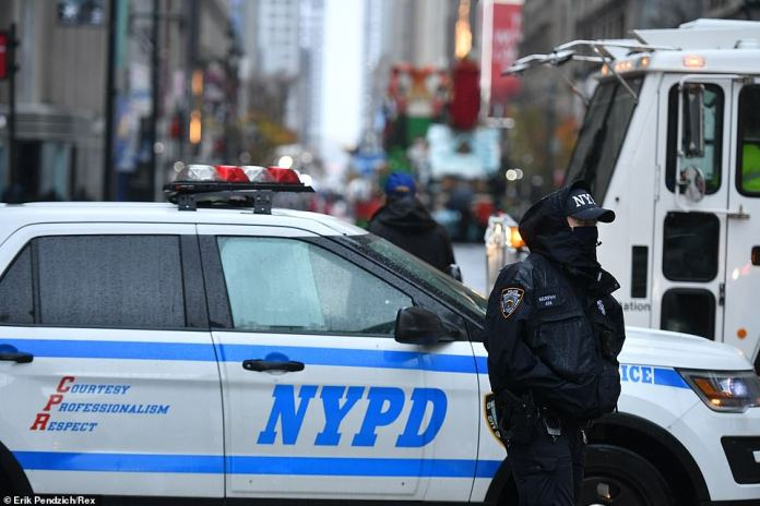 Police officers block of access to Herald Square during the Macy's Thanksgiving Day Parade on Thursday morning