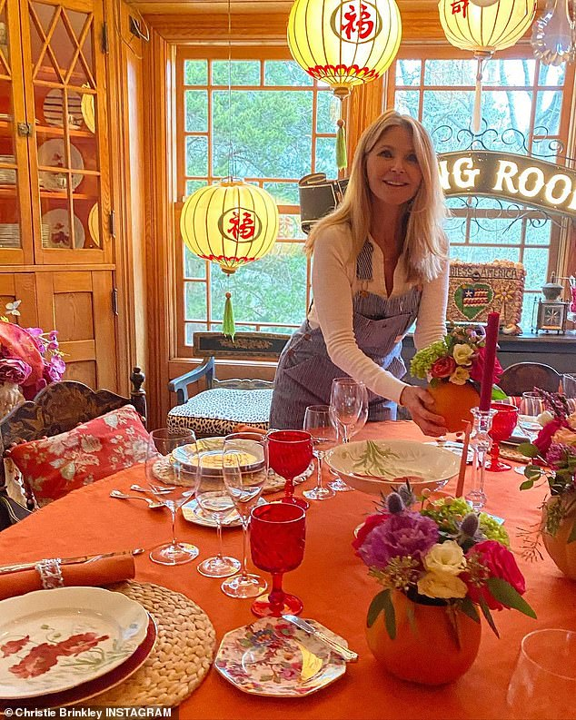 Red and orange work well:Christie Brinkley let fans see her beautifully appointed T-day table