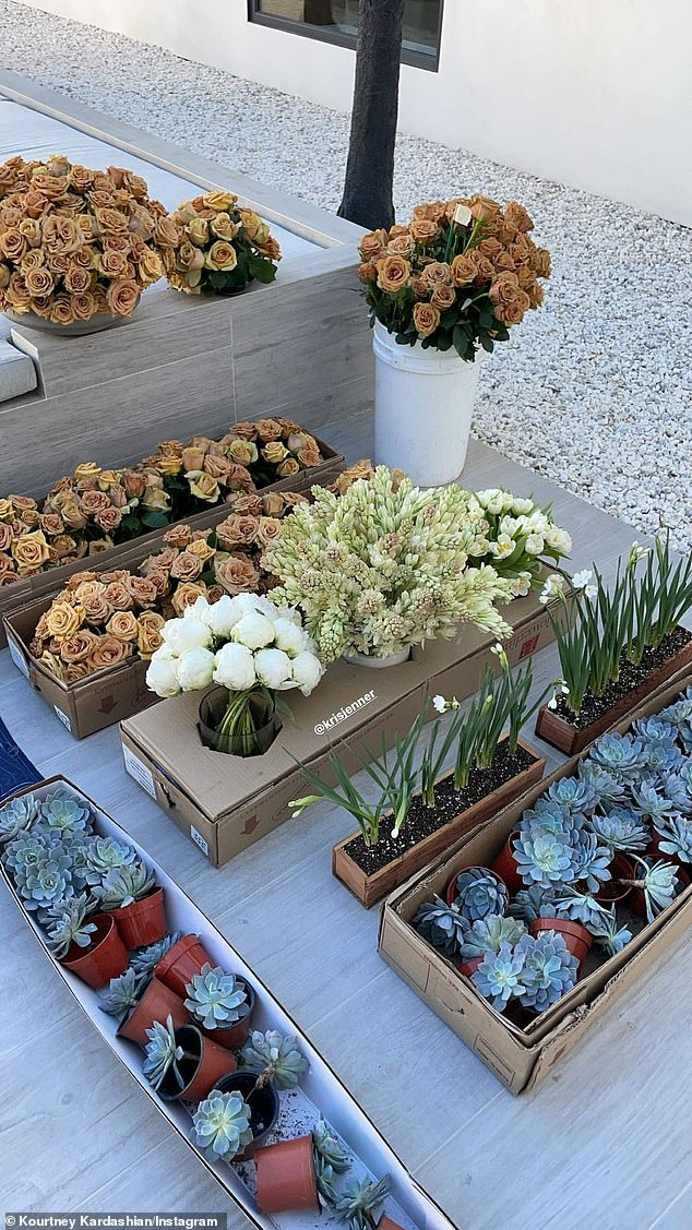 Ready to go:Kourtney Kardashian showed off the flowers should would be using on the holiday