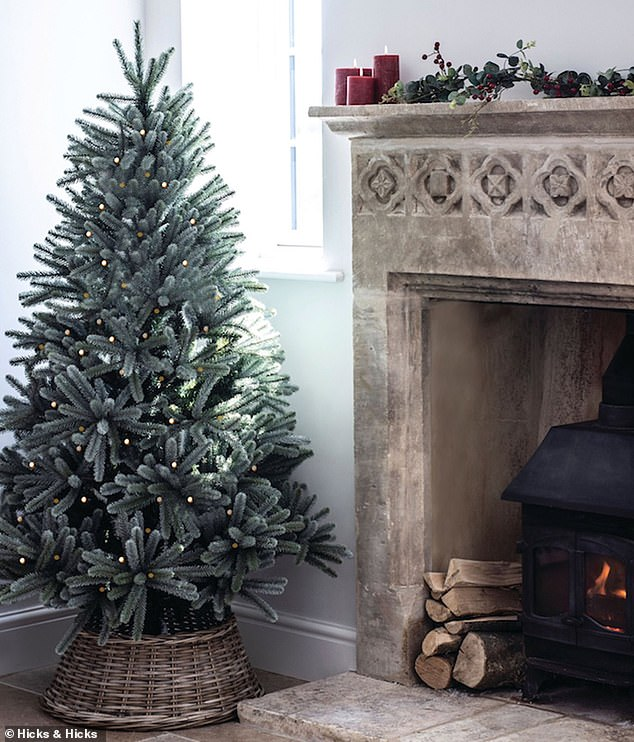Designer Steph Briggs, founder of interior and gifts emporium, La Di Da Interiors, says it's vital you cover up the legs if you go for an artificial tree and recommends investing in a woven willow tree skirt (pictured)