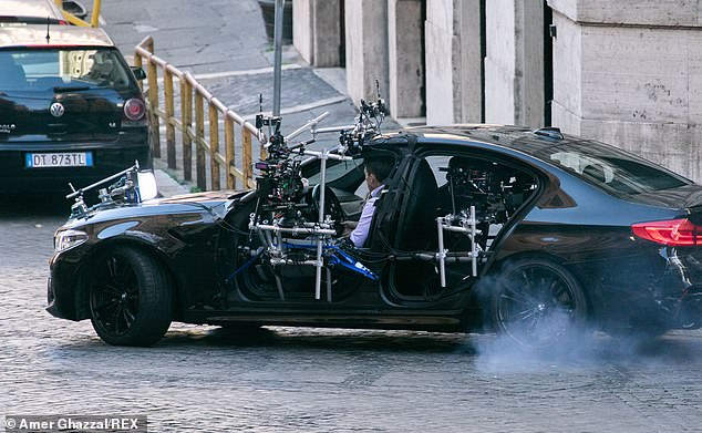 Leading man:Tom was on fine form as he took the wheel while filming scenes alongside the Agent Carter star
