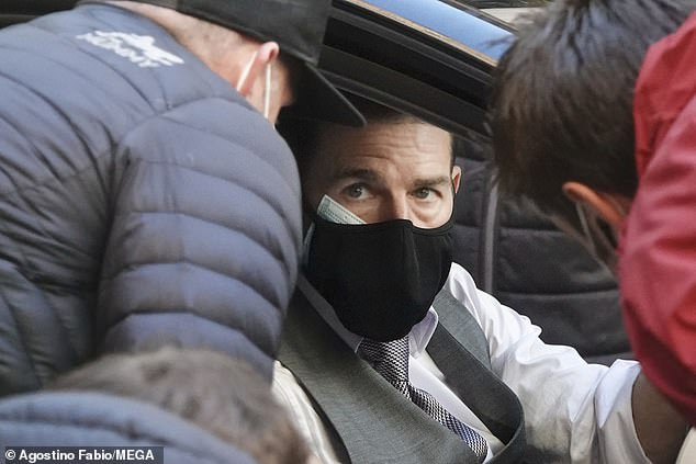 Conversation:In between having a laugh on set, Tom was also focused as he spoke to members of the crew between scenes, while staying protected with a black face mask